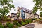 Kuren in Polen: Außenansicht vom Kurhaus Max in Henkenhagen Ustronie Morskie
